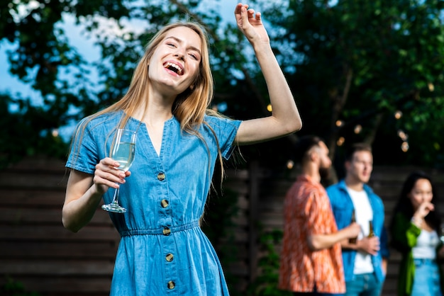 Happy young girl holding champagne glass Free Photo