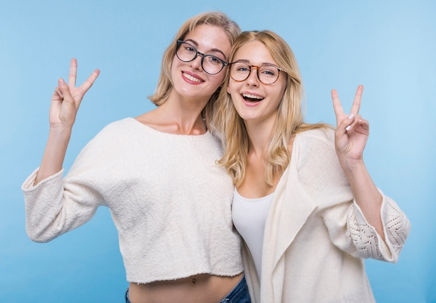 Happy young girls with glasses together Free Photo