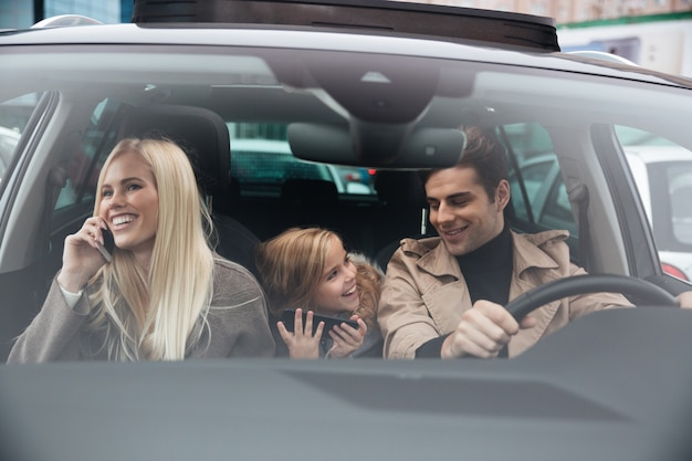 Happy young man with family in car Free Photo