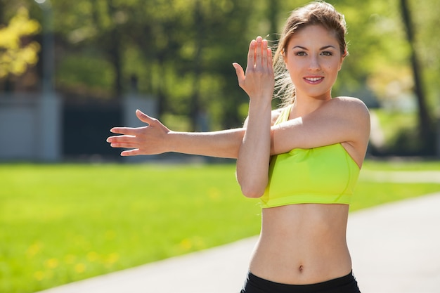 Happy young woman exercising outdoors Free Photo