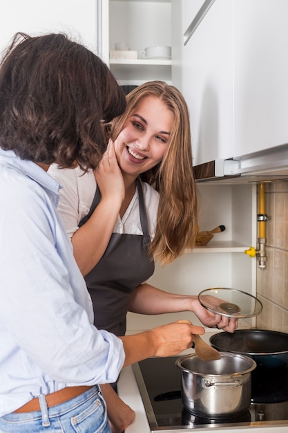 Happy young woman preparing the food in the kitchen Free Photo