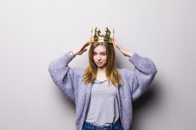 Happy young woman or teen girl in princess crown isolated on gray Free Photo