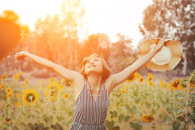 Happy young woman with open arms Free Photo