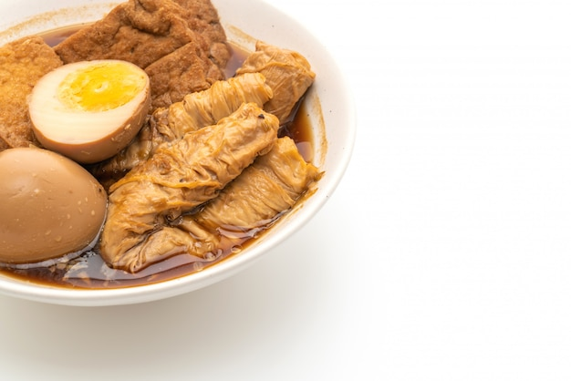 Hard-boiled egg in brown sauce or sweet gravy isolated on white background Premium Photo