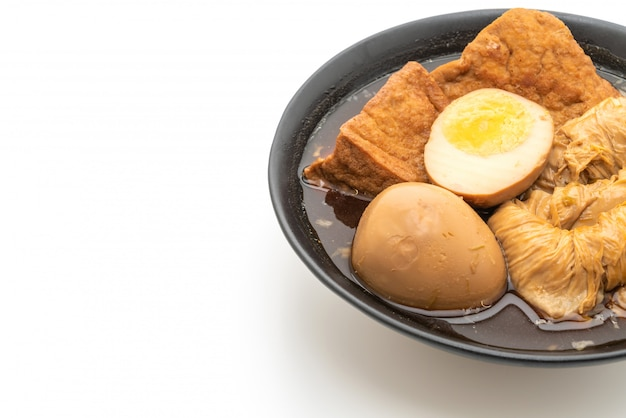 Hard-boiled egg in brown sauce or sweet gravy isolated Premium Photo