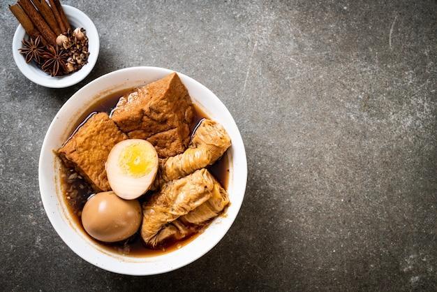 Hard-boiled egg in brown sauce or sweet gravy Premium Photo