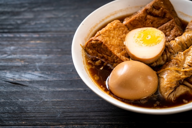 Hard-boiled egg in brown sauce or sweet gravy Premium Photo