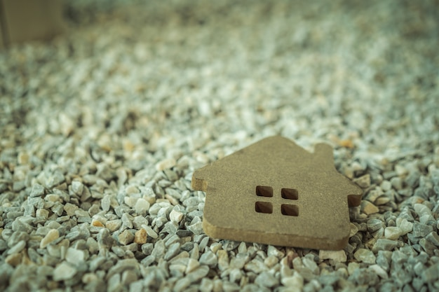 Hard paper house on the table, a symbol for construction , Premium Photo