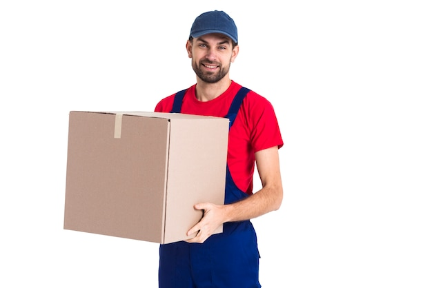 Hard worker courier man holding a big box Free Photo