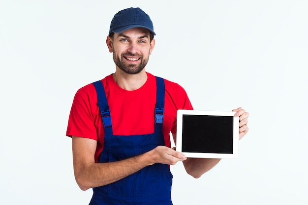 Hard worker courier man holding a tablet medium shot Free Photo