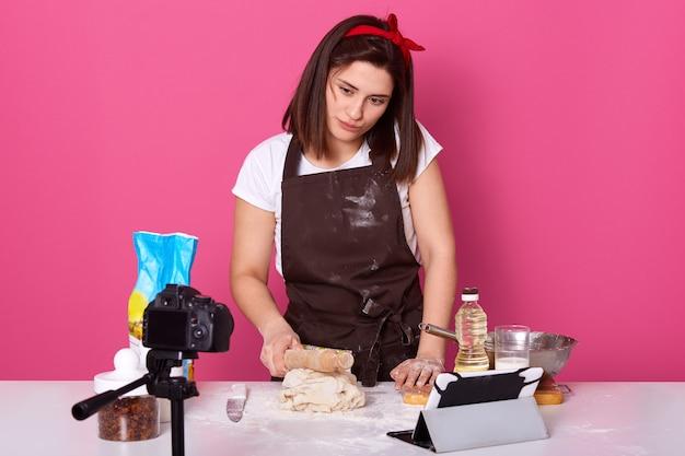 Hard working brunette housewife trying new recipe Premium Photo