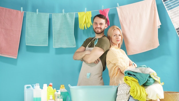 Hard-working couple is ready to help you with laundry. laundry service Premium Photo