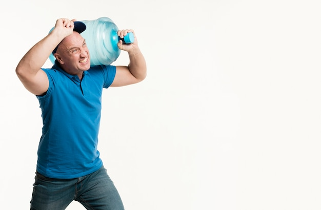 Hard working delivery man holding water bottle Free Photo