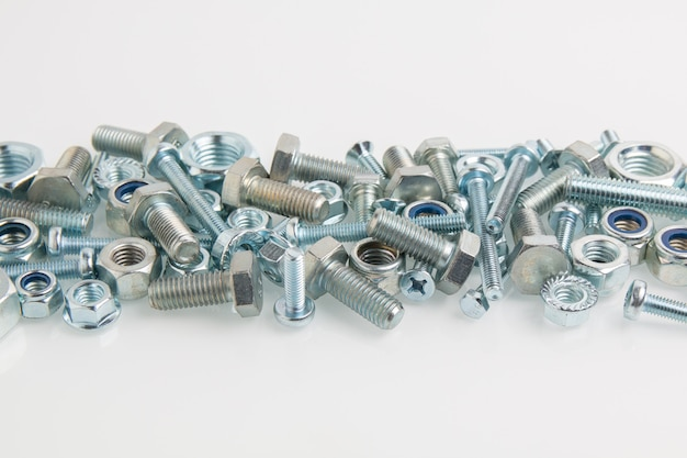 Hardware, bolts, screws and nuts close-up Premium Photo