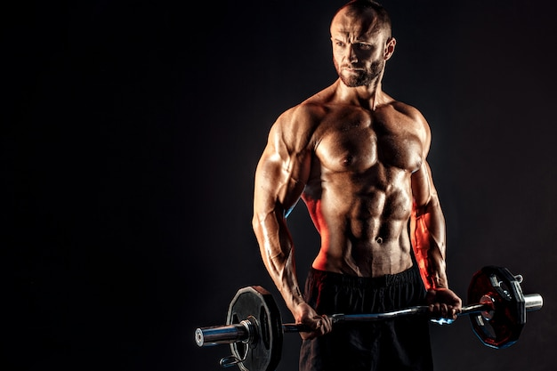 Hardy man doing exercise with heavy bar Premium Photo