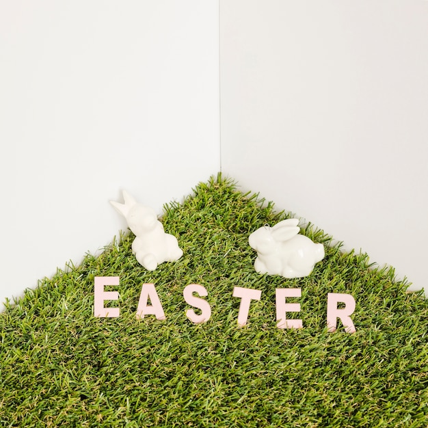 Hare figurines and easter word Free Photo