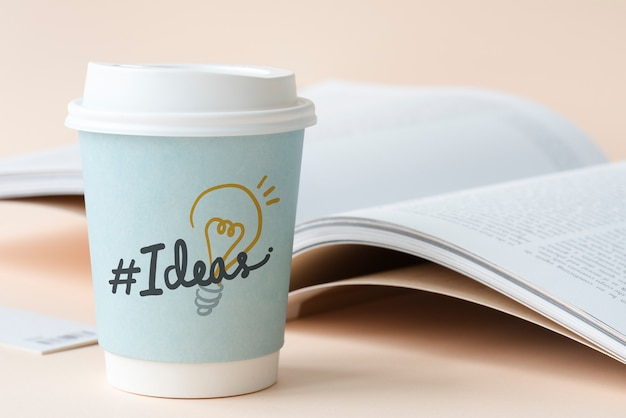 Hashtag ideas on a paper cup Premium Photo
