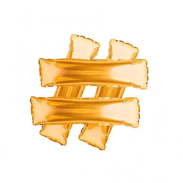 Знак хэштег из золотых шаров, изолированные на белом. символ хештега, обмен тегами сообщения. тенденции в социальных сетях. золотые воздушные шары с буквами Premium Фотографии