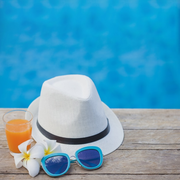 Swimming Pool Background hat, sunglasses and drink with swimming pool background photo