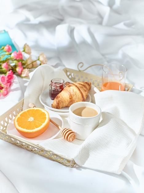 Having breakfast on bed Free Photo