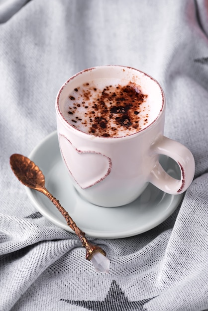 Having a cup of coffee with chocolate on blanket in bed Premium Photo