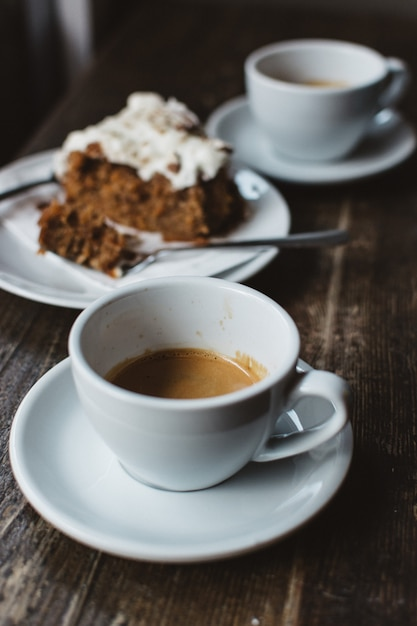 Having espresso with carrot cake Free Photo