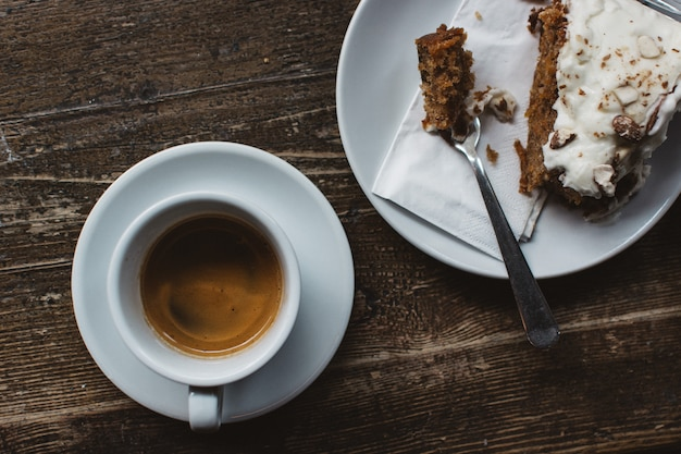 Having espresso with carrot cake Free Photo