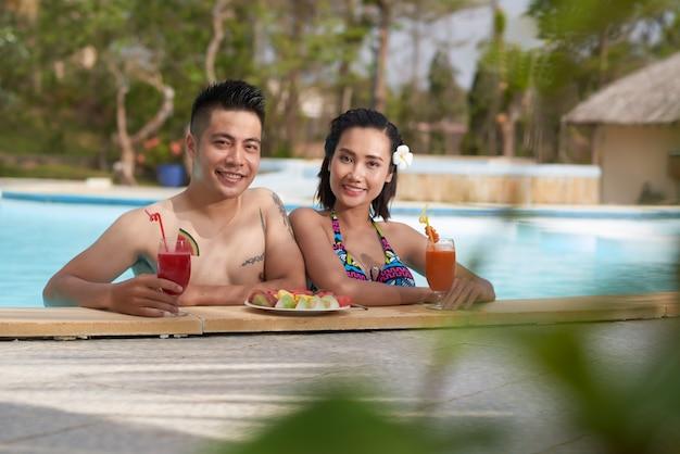 Having fun in outdoor swimming pool Free Photo