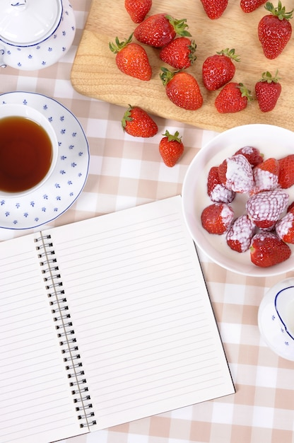 Having some strawberries with tea Free Photo