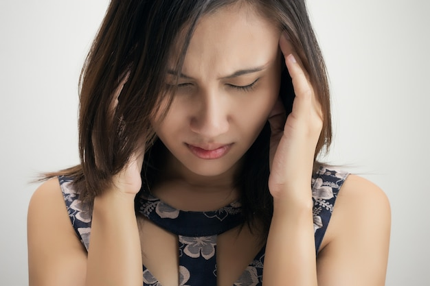 Headache against white background against gray background Premium Photo