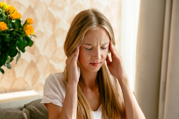 Headache of woman, head pain and stress or depression concept. Free Photo