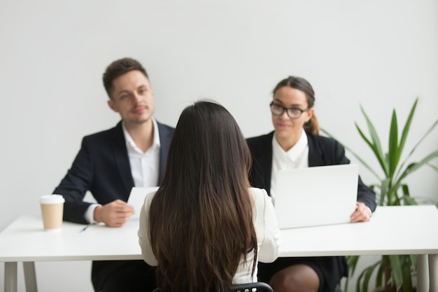 Headhunters interviewing female job candidate Free Photo