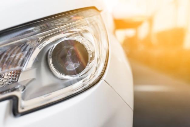 Headlight of new white auto on street Free Photo