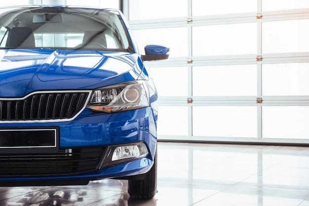 The headlights and hood blue car Premium Photo