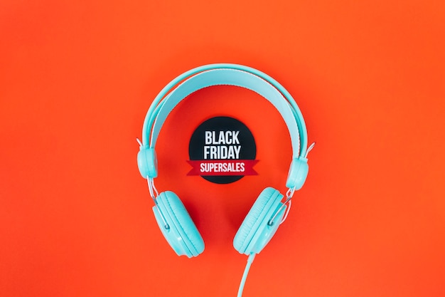 Headphones around black friday label Free Photo