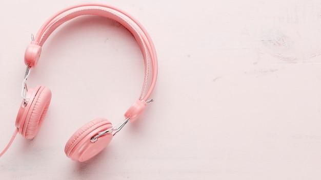 Headphones on light background Free Photo