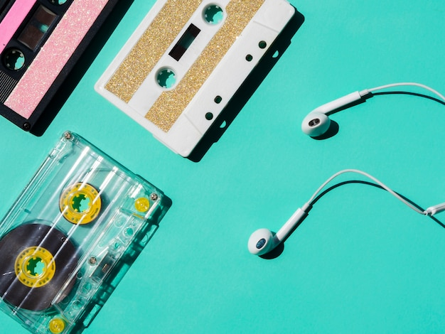 Headphones near cassette tape collection Free Photo