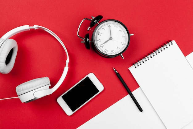 Headphones with cord on red and white color background Premium Photo