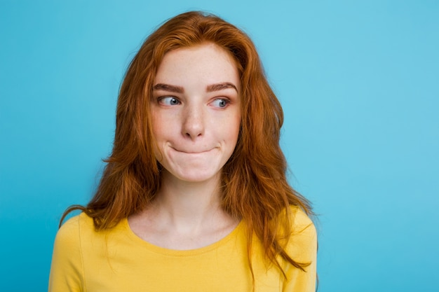 headshot portrait of happy ginger red hair girl with freckles
