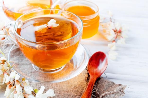Healing acacia herbal tea and flowers Premium Photo