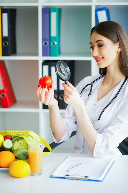 Health. diet and healthy. doctor dietitian holding in hands fres Premium Photo