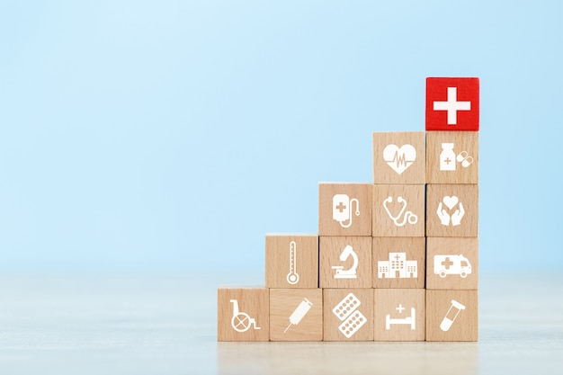 Health insurance concept. wood block stacking with icon healthcare medical. Premium Photo