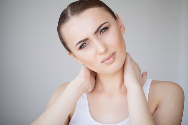 Health and neck pain. beautiful woman feeling sick, having headache, painful body pain Premium Photo