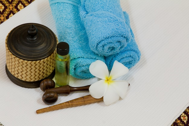 Health spa with white flower bottles with essential oil photo health spa with white flower bottles with essential oil free photo mightylinksfo