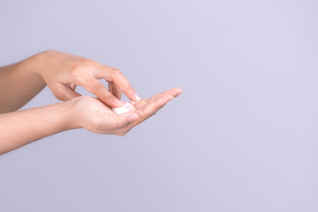 Healthcare concept. closeup shot of young woman hands applying moisturizing hand cream. Premium Photo