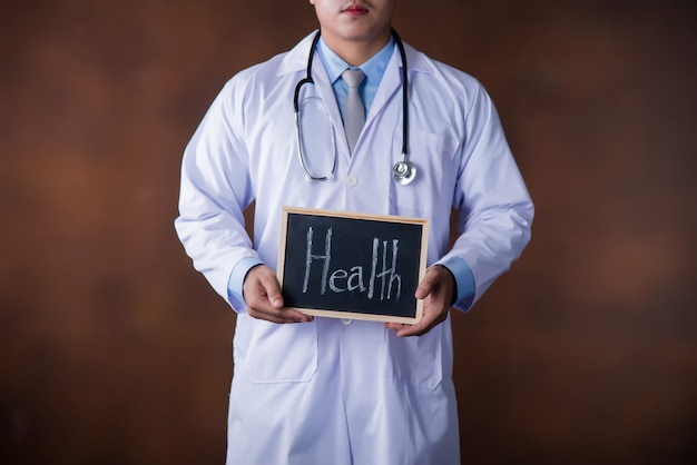 Healthcare man, professional doctor working in hospital office or clinic Free Photo
