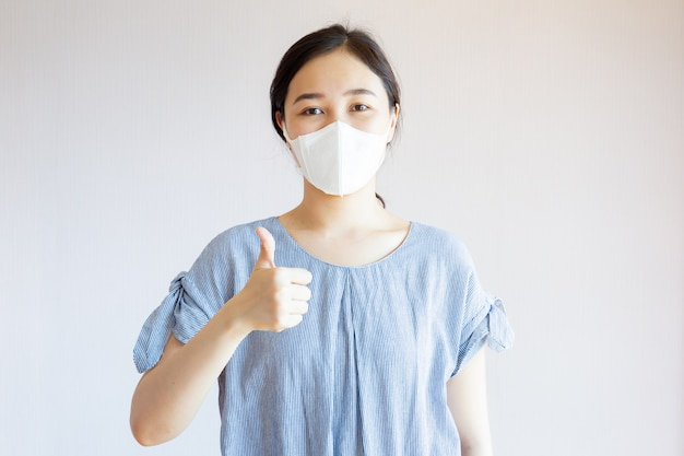 Healthy asian woman with mask Premium Photo