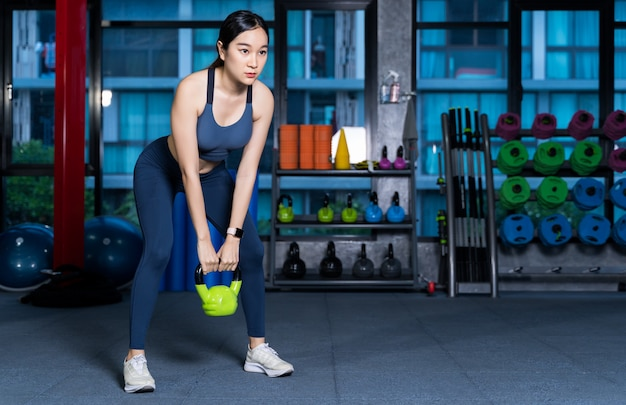 Healthy asian women are doing lifting gear, Premium Photo