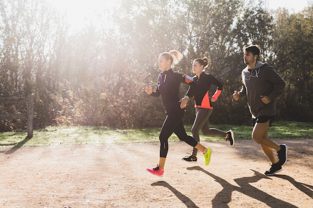 Healthy athletes running sunny day 23 2147600764