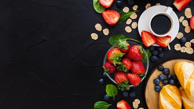 Healthy breakfast on a black wooden background. top view. free space for your text Free Photo